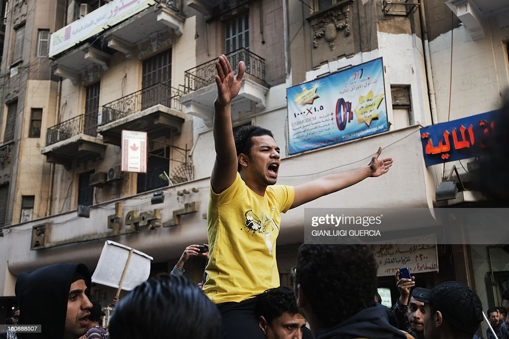 An Egyptian anti-government protester shouts slogans during a demonstration in the city center of the Egyptian capital Cairo to protest against the death of protesters, during last week's demonstrations against Morsi and his Muslim Brotherhood on February 7, 2013. A 23-year-old man, Mohammed Hussein Qarni died of a gunshot wound outside the presidential palace on February 1, where stone and petrol bomb throwing protesters faced off with police into the night.