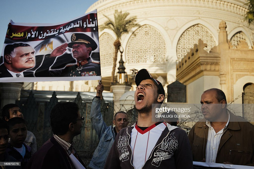 An Egyptian anti-government protester shouts slogans outside the presidential palace in Cairo during a demonstration against Egypt's President Mohamed Morsi and the Muslim Brotherhood on February 8, 2013. Thousands took to the streets across Egypt after opposition groups called for 'Friday of dignity' rallies demanding Morsi fulfill the goals of the revolt that brought him to power.