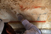 An Egyptian archaeologist restores the wall inside one of two 3000 year old tombs of senior pharaonic generals that were discovered in the famed...