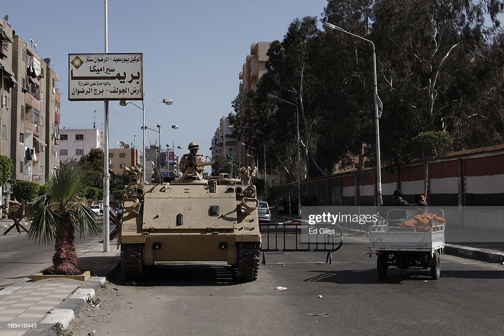 An Egyptian armoured vehicle stands guard outside the Port Said prison prior to the announcement of the final verdict in the case of the Port Said football massacre, on March 9, 2013, in Port Said, Egypt. Over seventy football fans of the Al Masry team were killed during a stadium brawl that took place after a match between the Al Masry and Al Ahly teams in the northern Egyptian city in February 2012. Two senior police officers, the Port Said Security Director Essam Samak and head of the Port Said Water Bodies Security Department, Mohammed Saad, received 15 year sentences, while seven other police officers were acquitted. Five Port Said citizens received life sentences on Saturday, and twenty one civilian death sentences handed down in a January ruling on the same case were confirmed. (Photo by Ed Giles/Getty Images).