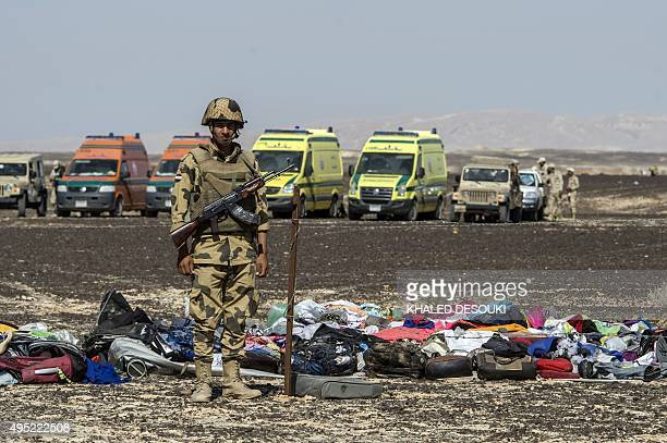 An Egyptian army soldier stands guard next to the luggage and belongings of passengers of the A321 Russian airliner piled up at the site of the crash...