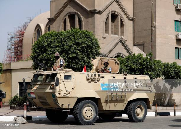 An Egyptian army vehicle stands guard outside Saint Mark's Coptic Orthodox Cathedral in central Cairo a few hours before Pope Francis' visit...