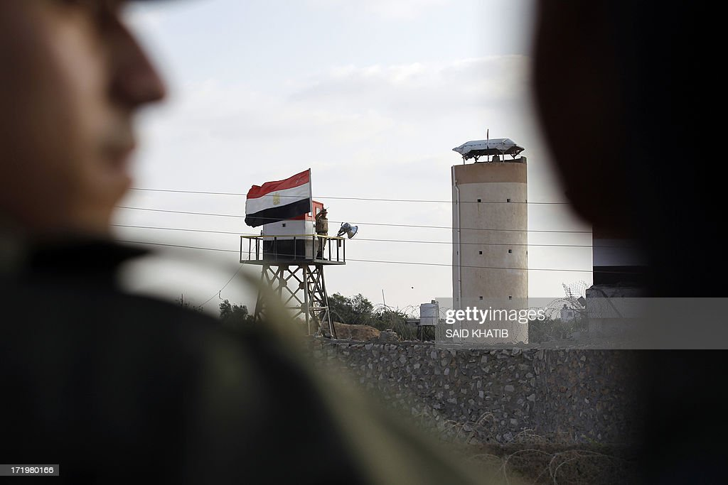 An Egyptian border post is seen close to the Rafah area in the Gaza Strip on the border with Egypt on June 30, 2013. Hamas security forces boosted its security presence along the border between the Gaza Strip and Egypt as Egypt prepares for massive demonstrations organized by opponents of President Mohamed Morsi, demanding his 'departure' on the first anniversary of the coming to power. AFP PHOTO / SAID KHATIB.