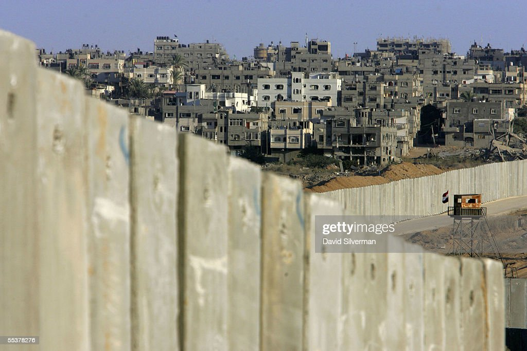 An Egyptian border post overlooks Israel's protective barrier and the Palestinian town of Rafah September 11 2005 along the Philadelphi Corridor on...