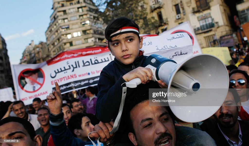 An Egyptian boy holds a megaphone while chanting anti-government slogans in Tahrir Square the afternoon of January 31, 2011 in central Cairo, Egypt. Protests continued unabated in Cairo January 31, as thousands marched to demand the resignation of Egyptian President Hosni Mubarak.