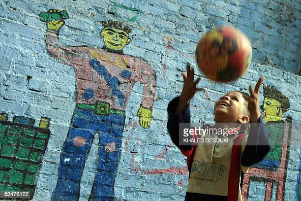 An Egyptian boy plays with a ball at the poor area of alZabbalin in Cairo on October 20 2008 where FrancoBelgian Sister Emmanuelle spent 20 years...