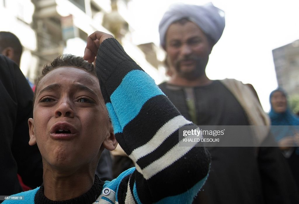 An Egyptian boy reacts outside the courtroom in Egypt's southern province of Minya after an Egyptian court sentenced Muslim Brotherhood leader Mohamed Badie and other alleged Islamists to death on April 28, 2014. The defendants were accused of involvement in the murder and attempted murder of policemen in Minya province on August 14, the day police killed hundreds of ousted Islamist president Mohamed Morsi's supporters in clashes in Cairo.