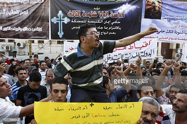 An Egyptian Copt shouts slogans during a demonstration outside the Abbassiya Cathedral of Saint Marcos in Cairo on June 9 against the high...