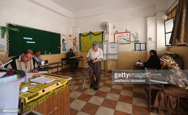 An Egyptian Coptic man walks to cast his vote at a polling station on the second day of Egypt's presidential election on May 27 2014 in the capital...