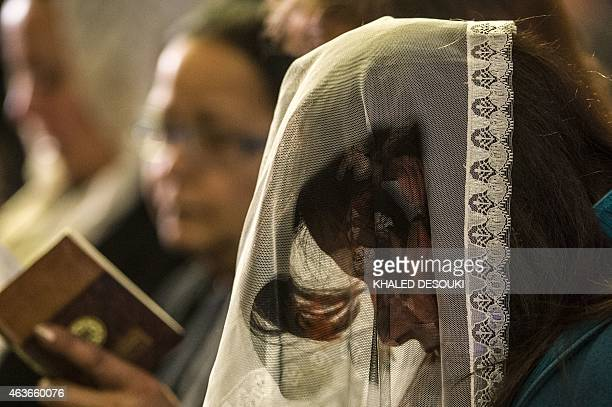 An Egyptian Coptic woman attends a mass led by Egypt's Coptic Pope Tawadros II to honor the memory of the Egyptian Coptic Christians murdered by...
