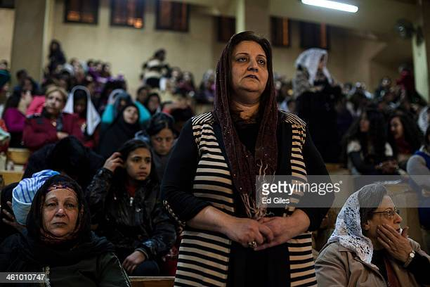 An Egyptian Coptic woman prays during a Christmas Eve mass in a chapel at the St Saman Monastery in the Manshiet Nasser district on January 6 2014 in...
