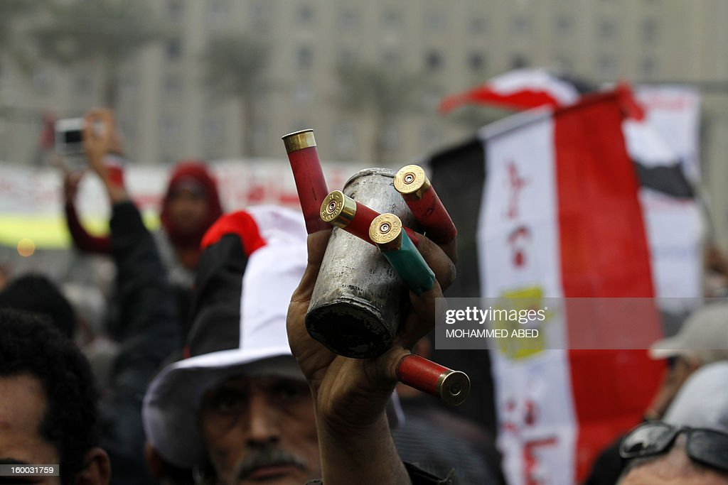 An Egyptian demonstrator holds up an empty tear gas canister during a protest in Tahrir Square on January 25, 2013 in Cairo. Huge crowds are expected to demonstrate in Egypt on the second anniversary of the revolution that ousted Hosni Mubarak and brought in an Islamist government, as political tensions simmer and economic woes bite.