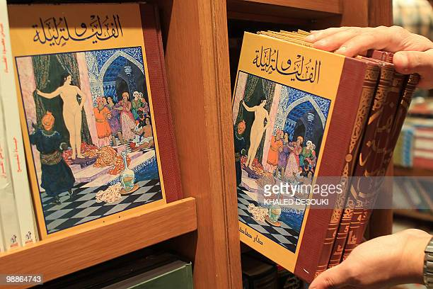 An Egyptian employee puts copies of 'One Thousand and One Nights' known in English as 'Arabian Nights' on a shelf at a bookstore in Cairo on May 5...