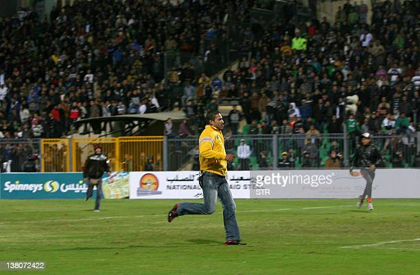 An Egyptian fan of AlMasry invades the pitch after a football match against AlAhly in Port Said on February 1 2012 At least 74 people were killed and...