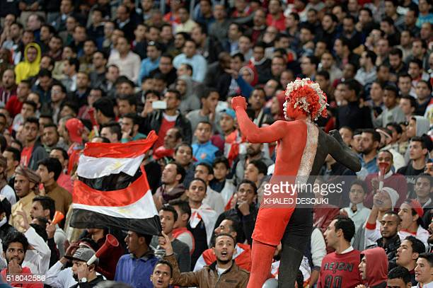 An Egyptian fan painted with national flag looks on during African Cup of Nations group G qualification football match between Egypt and Nigeria at...
