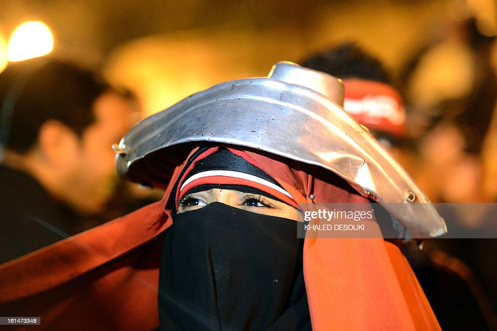 An Egyptian female protester attends a demonstration in front of the presidential palace in Cairo, on February 11, 2013, during opposition held rallies to mark the second anniversary of former president Hosni Mubarak's overthrow.