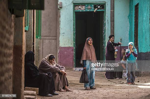 An Egyptian girl pauses in an alley in the village of alJendyaa in the Bani Mazar province in the Minya governorate south of Cairo on April 5 2016 /...