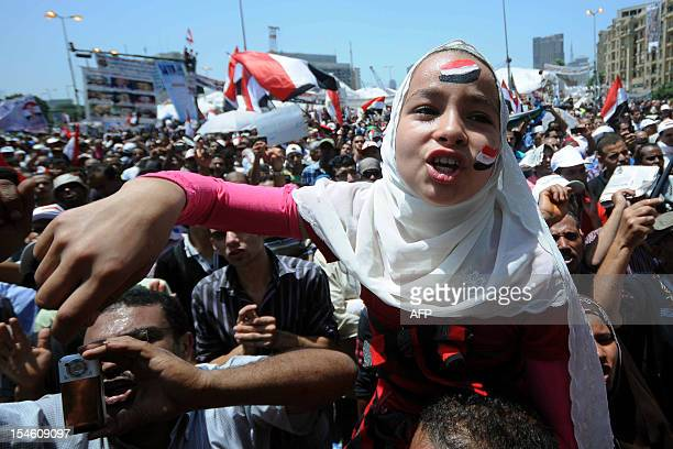 An Egyptian girl shouts slogans as prodemocracy protesters gather in Cairo's Tahrir Square to push for reforms on July 22 2011 AFP PHOTO/MOHAMED...
