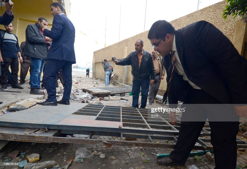 An Egyptian investigation team inspects damages at the Port Said Stadium on February 2 a day after deadly clashes between rival football fans after a...