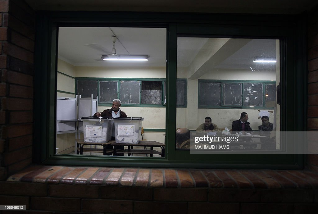 An Egyptian man casts his ballot during the second round of a referendum on a new draft constitution in Giza, south of Cairo, on December 22, 2012. Egyptians are voting in the final round of a referendum on a new constitution championed by President Mohamed Morsi and his Islamist allies against fierce protests from the secular-leaning opposition.