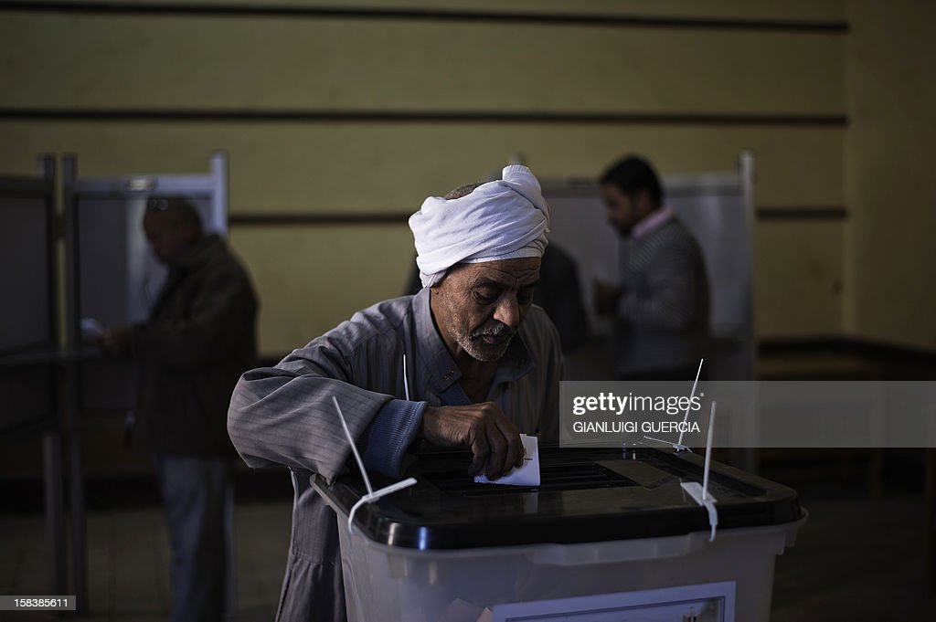 An Egyptian man casts his vote at a polling station in President Mohamed Morsi's hometown Zagazig in the Nile Delta on a new constitution supported by the ruling Islamists but bitterly contested by a secular-leaning opposition on December 15, 2012. Morsi's determined backing of the charter triggered the power struggle with the opposition, which is supported by judges who accuse the Islamists of overreaching.