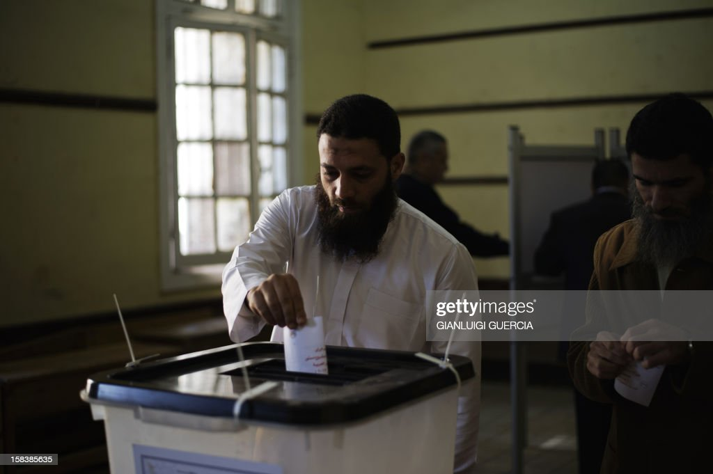 An Egyptian man casts his vote at a polling station in President Mohamed Morsi's hometown Zagazig in the Nile Delta on a new constitution supported by the ruling Islamists but bitterly contested by a secular-leaning opposition on December 15, 2012. Morsi's determined backing of the charter triggered the power struggle with the opposition, which is supported by judges who accuse the Islamists of overreaching. AFP PHOTO/GIANLUIGI GUERCIA