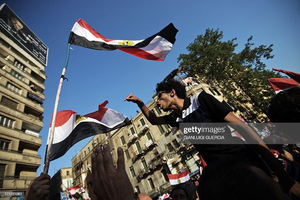 An Egyptian man chants slogans during a demonstration against president Mohamed Morsi and the Muslim Brotherhood in Egypt's landmark Tahrir square on...