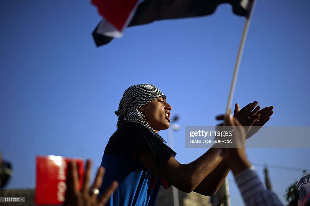 An Egyptian man chants slogans during a demonstration against president Mohamed Morsi and the Muslim Brotherhood in Egypt's landmark Tahrir square on June 28, 2013. Supporters and opponents of Egyptian Islamist President Mohamed Morsi took to the streets for rival protests a year after his election, as clashes in Alexandria raised fears of widespread unrest.