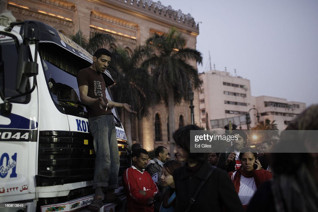 An Egyptian man gestures to a group of passing protesters taking part in a march against sexual harassment near the Seiyda Zeinab Mosque, on February 6, 2013 in Cairo, Egypt. Around a thousand Egyptian men and women marched through the Egyptian capital to the city's iconic Tahrir Square on Wednesday to demonstrate against the continuing problem of sexual harassment of Egyptian and foreign women during protests across Egypt. (Photo by Ed Giles/Getty Images).
