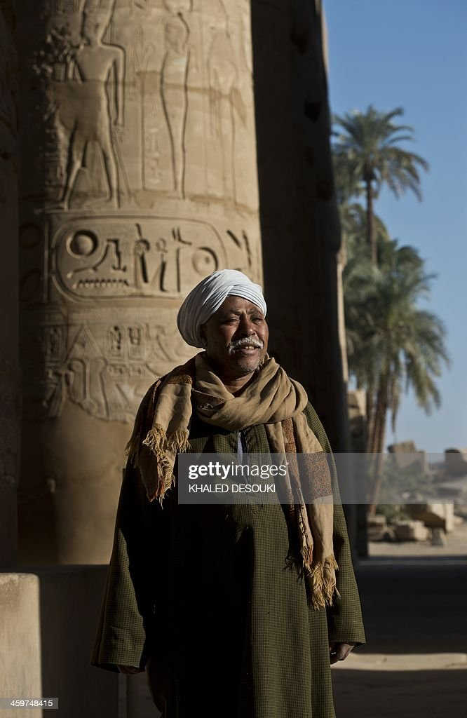 An Egyptian man guards on December 21, 2013 the Temple of Karnak, in the southern Egyptian city of Luxor. The 2011 revolution that toppled dictator Hosni Mubarak dealt a severe blow to the country's tourist industry, once a mainstay of Egypt's economy.