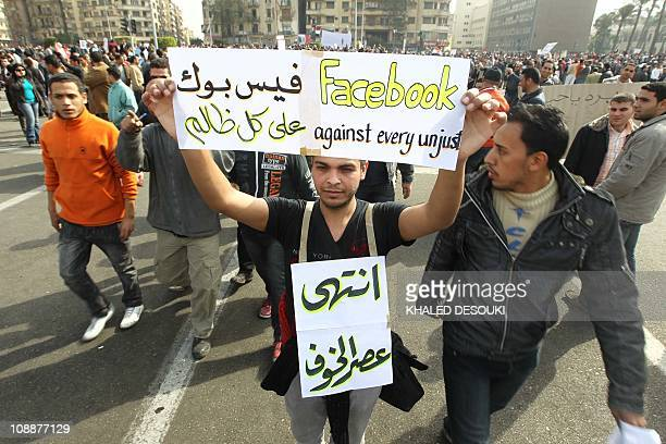An Egyptian man hold up a sign praising the social network website Facebook joins others in Cairo's Tahrir Square heeding a call by the opposition...