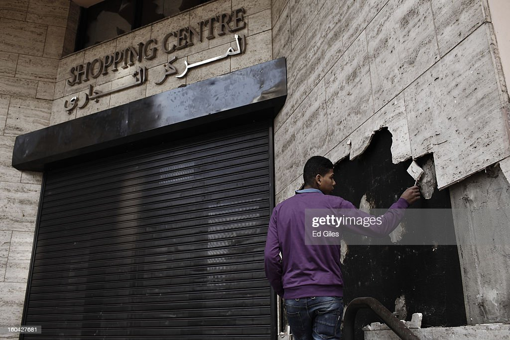 An Egyptian man inspects damage to the outer walls of a luxury hotel vandalized during earlier clashes between riot police and protesters near Tahrir Square on January 31, 2013 in Cairo, Egypt. Several luxury hotels on the banks of the Nile River in central Cairo were forced to close after being surrounded by violent demonstrations and in one case, being broken into. Protests continued across Egypt nearly one week after the second anniversary of the Egyptian Revolution that overthrew former President Hosni Mubarak on January 25, 2011. Further protests are expected over the coming weekend to commemorate the first anniversary of the Port Said football massacre, when over 70 fans of the Cairo-based Al Ahly football club were killed in a violent post-match brawl between fans of the opposing teams inside the Port Said football stadium after a match between the Al Ahly and Al Masry football teams.