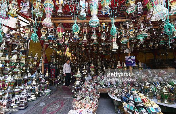 An Egyptian man looks at traditional Ramadan lanterns on display at a shop in the workingclass Saida Zeinab district in Cairo on the second day of...