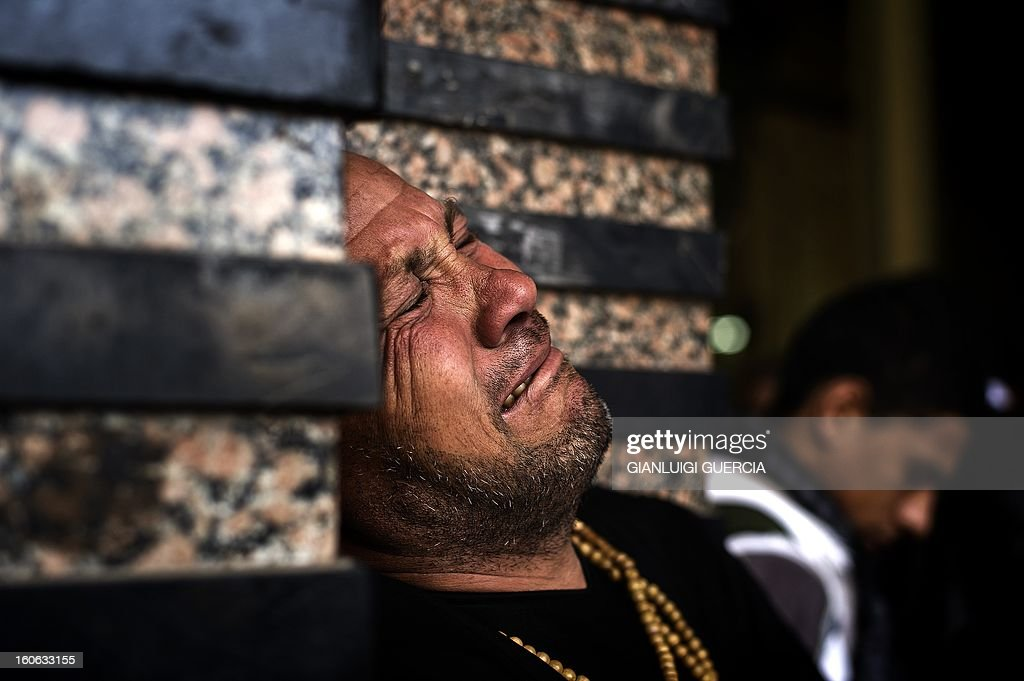 An Egyptian man mourn during the funeral of killed Egyptian activists Amro Saad and Mohammed al-Guindi outside Omar Makram Mosque in Cairo's Tahrir Square, on February 4, 2013. Saad died in clashes during anti-government protests on February 1, while Guindi, 28, went missing last month after joining protests demanding change on the second anniversary of Egypt's uprising against former president Hosni Mubarak and then slipped into a coma following days in police custody, according to the health ministry and his party. AFP PHOTO/GIANLUIGI GUERCIA