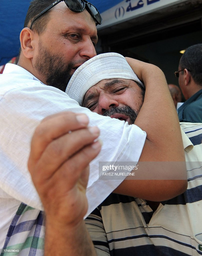 An Egyptian man mourns the death of a relative, shot dead in the Egyptian capital after violence erupted the night before, outside the Muslim Brotherhood field hospital in Cairo on July 27, 2013. The bloodshed came hours after the military-backed interior minister, Mohammed Ibrahim, warned a long-running sit-in at Cairo's Rabaa al-Adawiya mosque by Morsi loyalists would be ended 'in the framework of the law'.
