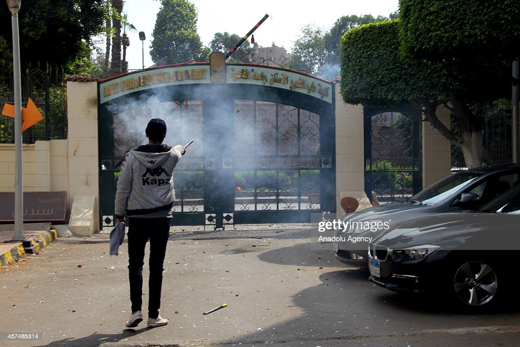 An Egyptian man sets off a firework during the clashes between Egyptian medical faculty students of Cairo University and baltagiya groups meaning as...
