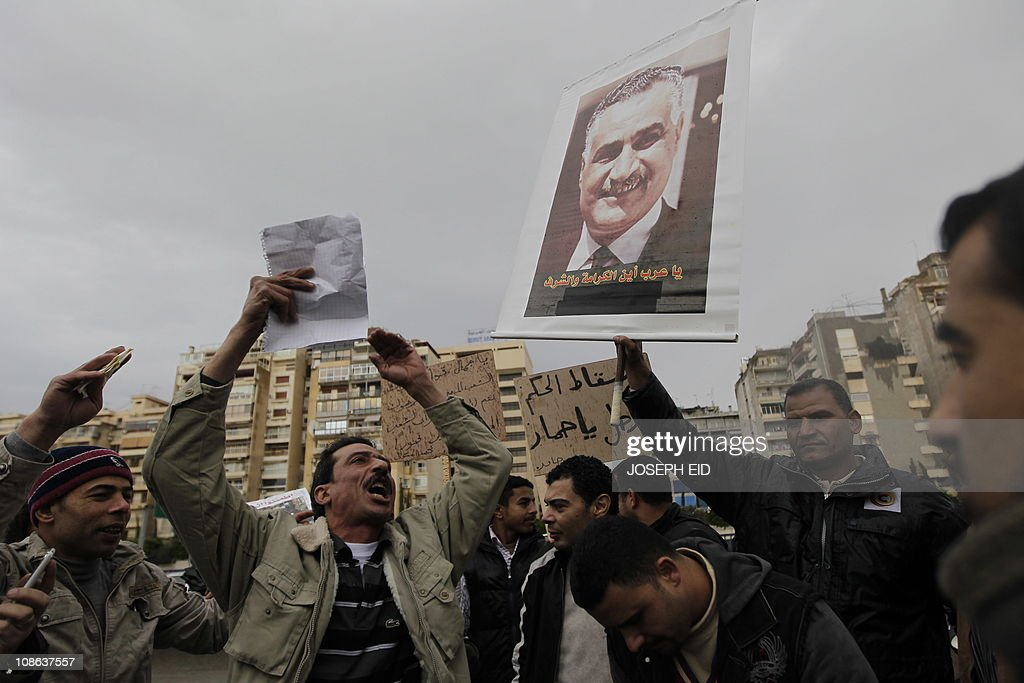 An Egyptian man shouts slogans during a protest by nationals living in Lebanon and leftist Lebanese activists outside the Egyptian Embassy in Beirut...