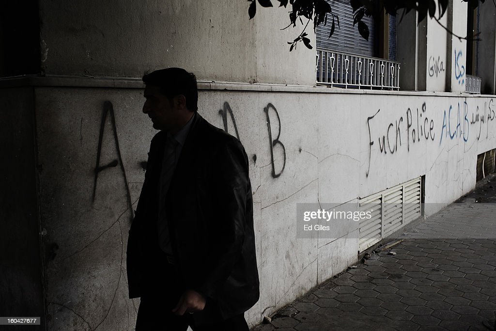 An Egyptian man walks by graffiti on the walls of a luxury hotel damaged during earlier clashes between riot police and protesters near Tahrir Square on January 31, 2013 in Cairo, Egypt. Several luxury hotels on the banks of the Nile River in central Cairo were forced to close after being surrounded by violent demonstrations and in one case, being broken into. Protests continued across Egypt nearly one week after the second anniversary of the Egyptian Revolution that overthrew former President Hosni Mubarak on January 25, 2011. Further protests are expected over the coming weekend to commemorate the first anniversary of the Port Said football massacre, when over 70 fans of the Cairo-based Al Ahly football club were killed in a violent post-match brawl between fans of the opposing teams inside the Port Said football stadium after a match between the Al Ahly and Al Masry football teams.