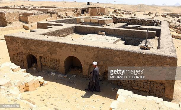 An Egyptian man walks past parts of the ancient Egyptian Saqqara necropolis some 20 kilometres south of Cairo on September 16 2014 Egypt tried to end...