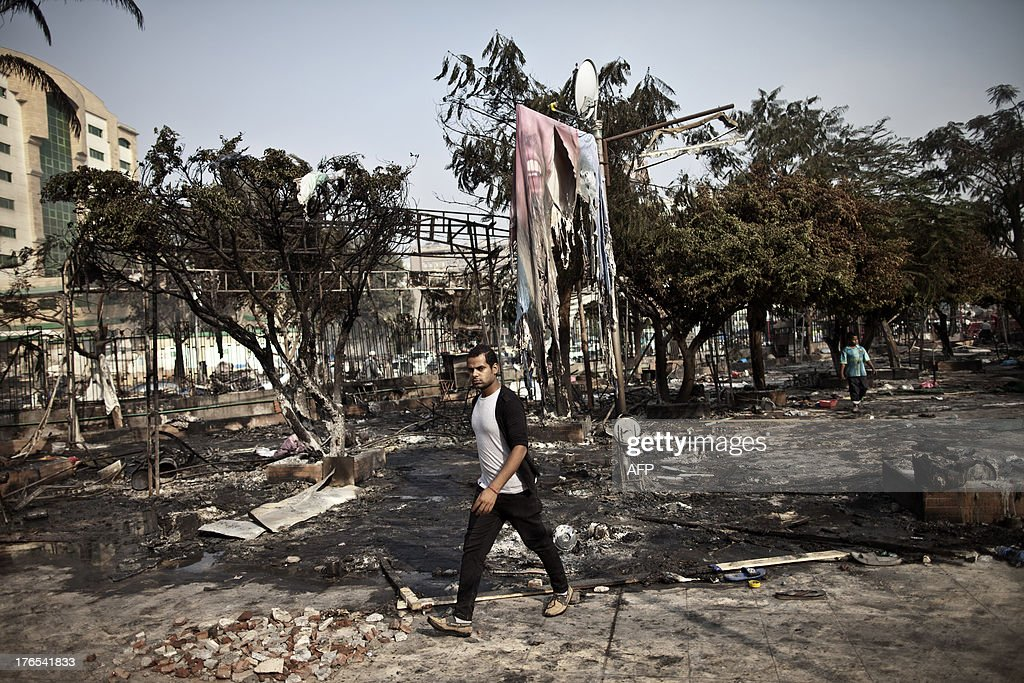 An Egyptian man walks through the debris at Rabaa alAdawiya square in Cairo on August 15 following a crackdown on the protest camps of supporters of...