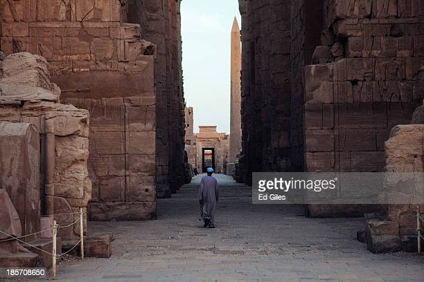 An Egyptian man walks through the empty Karnak Temple on October 22 2013 in Luxor Egypt Karnak is the largest ancient religious site in the world...