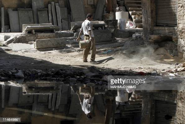 An Egyptian man works at a Cairo slum on March 17 2011 Forty percent of Egyptians live on two dollars a day or less according to the World Bank and...