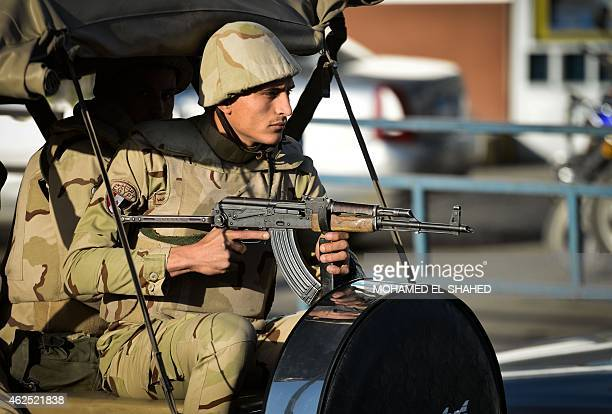 An Egyptian member of the armed forces patrols outside alMaza military airport where the bodies of the members of security forces who were killed in...