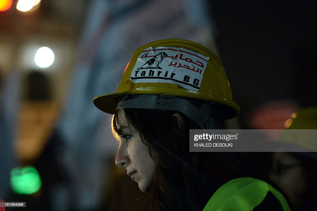 An Egyptian member of the Tahrir Bodyguards group wears a helmet which reads 'protecting Tahrir' during a demonstration against sexual harassment in Cairo on February 12, 2013. Egyptian protesters took to the street again to demand an end to sexual violence, as campaigns against the repeated attacks in central Cairo pick up steam.