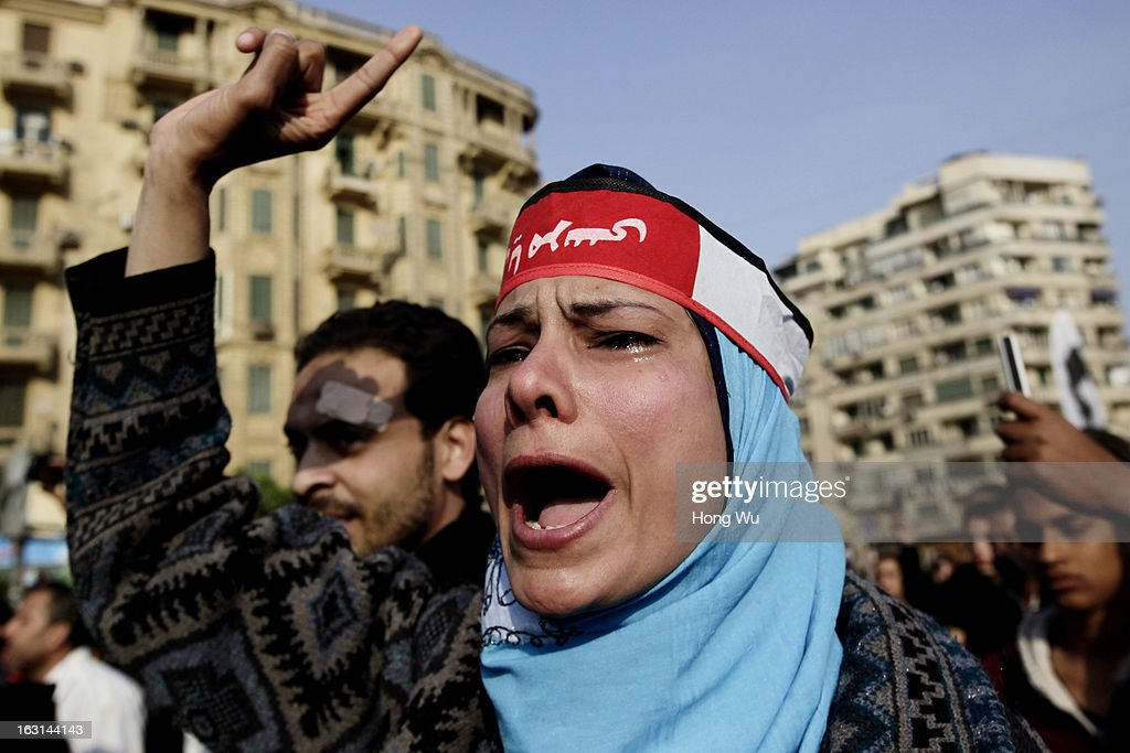 An Egyptian mourner cries and chants slogans during the funeral of Mohamed Elshafee, who died during violence marking the second anniversary of Egyption uprising and was only recently identified, on March 5, 2013 in Cairo, Egypt. Hundreds of protesters attend in the funeral and protest Egypt's President Mohamed Mursi.