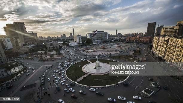 An Egyptian national flag flutters over Cairo's Tahrir Square on January 24 on the eve of the anniversary of the 2011 uprising On January 25 massive...