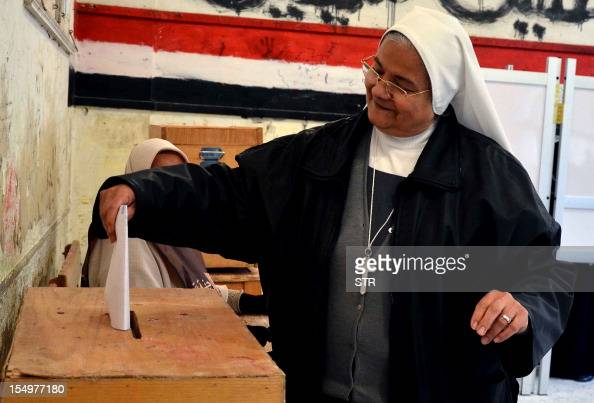 An Egyptian nun casts her ballot at a polling station in Damanhur in the coastal governorate of Buhaira on December 14 2011 Egyptians poured into...