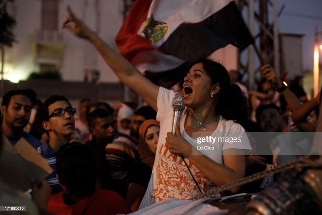An Egyptian opposition protester chants during a demonstration at the Egyptian Presidential Palace as part of the 'Tamarod' campaign on June 30, 2013 in Cairo, Egypt. Crowds of pro- and anti-Morsi protesters gathered in locations across Egypt on June 30, the day of a series of nation-wide mass demonstrations entitled 'Tamarod', or 'Rebel', planned to take place on the first anniversary of Morsi's election to the Egyptian Presidency. The 'Tamarod' campaign, organised by a coalition of opposition political groups, aims to bring down the government of President Morsi through country-wide demonstrations. (Photo by Ed Giles/Getty Images).