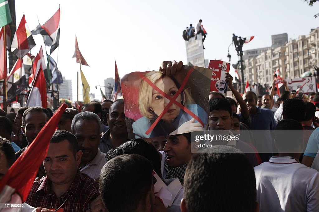 An Egyptian opposition protester holds a poster of the United States of America's Ambassador to Egypt, Ann Paterson, during a demonstration in Tahrir Square as part of the 'Tamarod' campaign on June 30, 2013 in Cairo, Egypt. Crowds of pro- and anti-Morsi protesters gathered in locations across Egypt on June 30, the day of a series of nation-wide mass demonstrations entitled 'Tamarod', or 'Rebel', planned to take place on the first anniversary of Morsi's election to the Egyptian Presidency. The 'Tamarod' campaign, organised by a coalition of opposition political groups, aims to bring down the government of President Morsi through country-wide demonstrations.