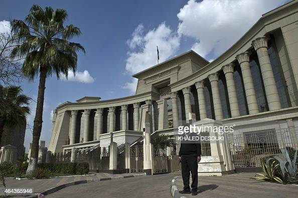 An Egyptian policeman stands guard outside the Supreme Constitutional Court in Cairo on February 25 2015 during a court session to determine if the...